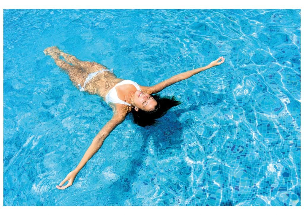 woman lying in pool