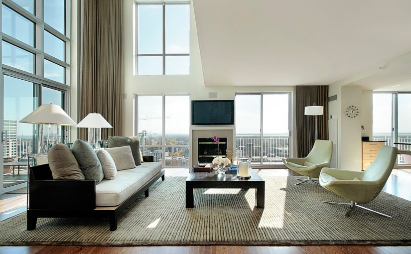 Living room in luxury condo with fireplace
