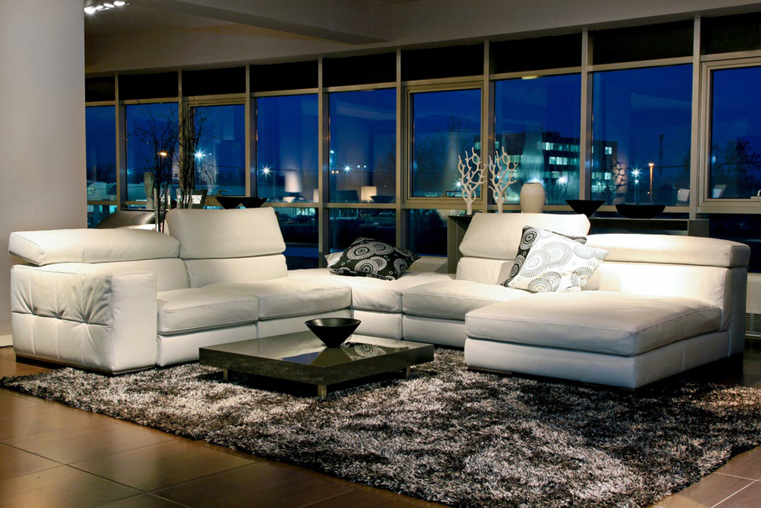 Spacious living room with beautiful view through glass wall
