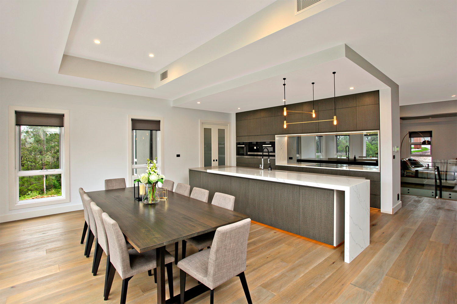 'One of a kind': a custom family home - open plan dining and kitchen