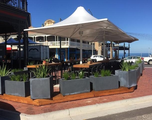 All-weather umbrellas: a contemporary upgrade - rain or sun umbrella: Ramsgate Hotel, Adelaide