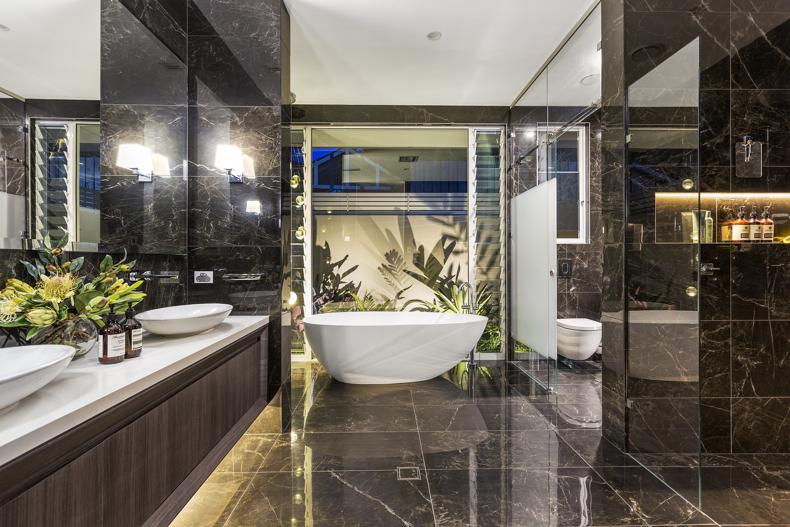 A high calibre custom home: clever lifestyle design - luxe bathroom with freestanding bath