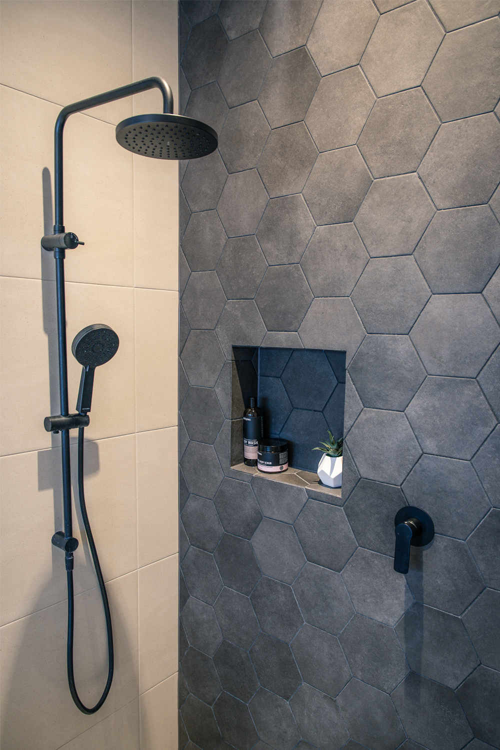 Ensuite project: a spacious design - shower head and hexagon feature tiles