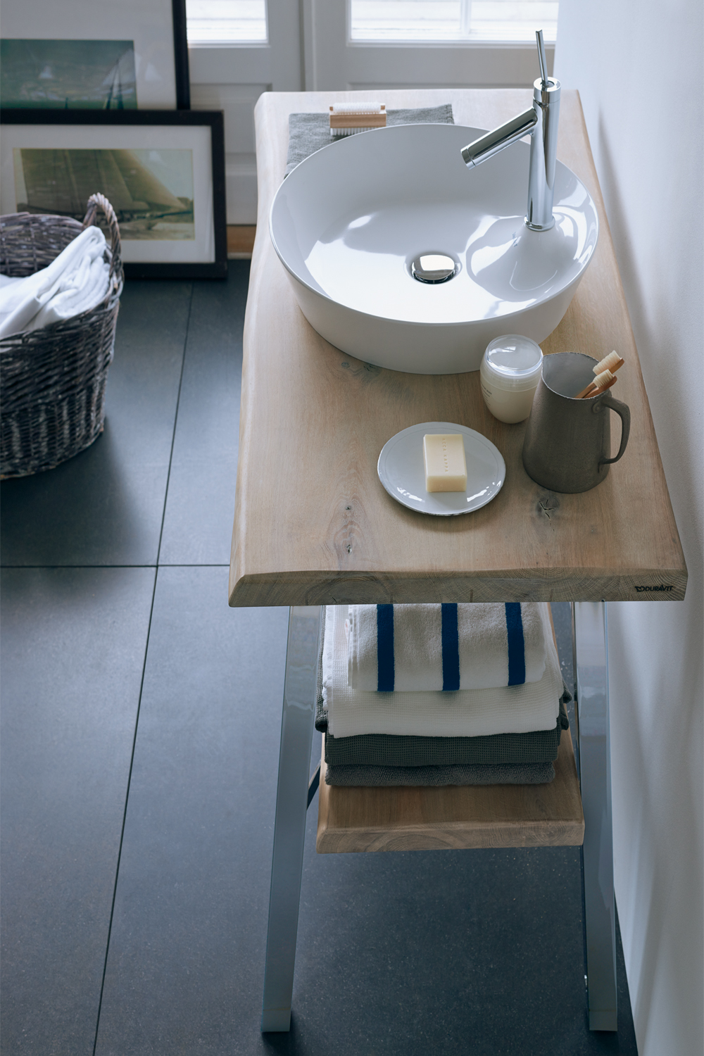 An innovative design: Philippe Starck's Cape Cod washbowl - wood timber vanity and cape cod basin by Philippe Starck