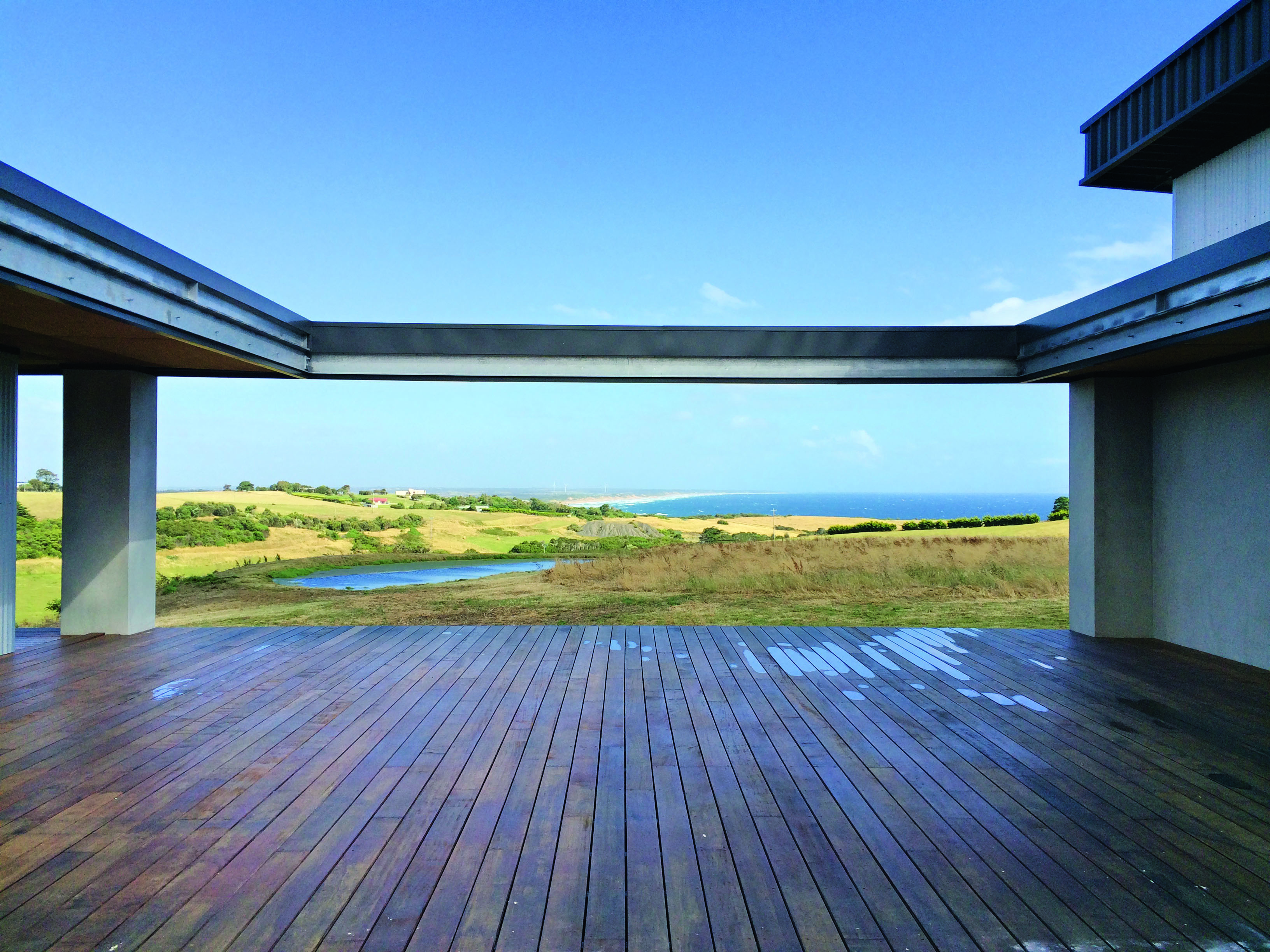 What type of holiday home does a commercial builder construct for his own family? - view from decking of Spantec holiday house