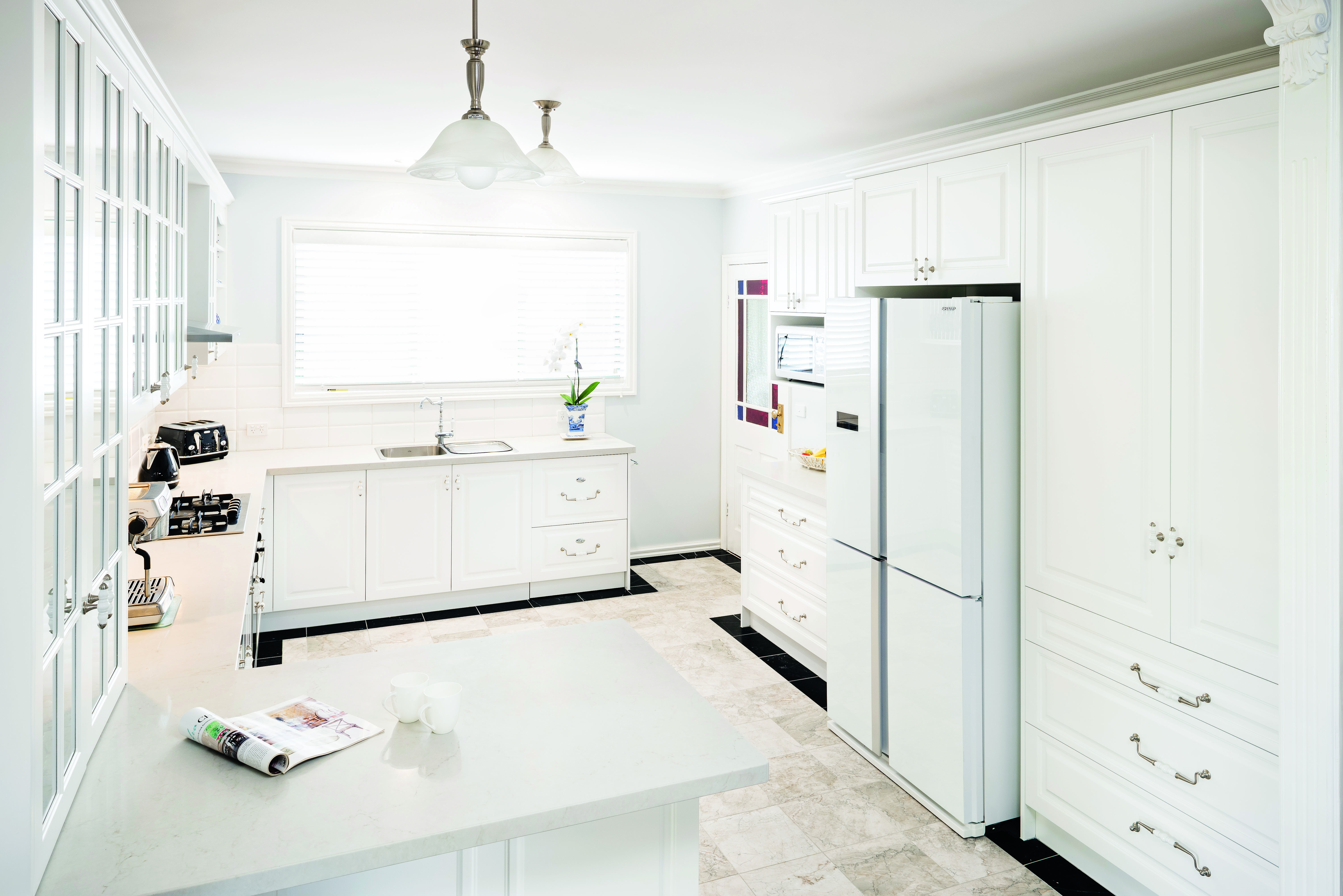 Provincial magic: a country style kitchen - fridge and cabinet view