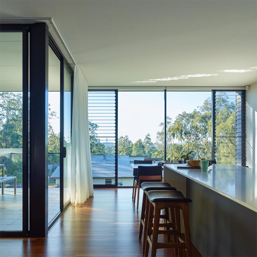 Grand Designs Australia: High Flyer - Architects' masterpiece - kitchen bar with view through window