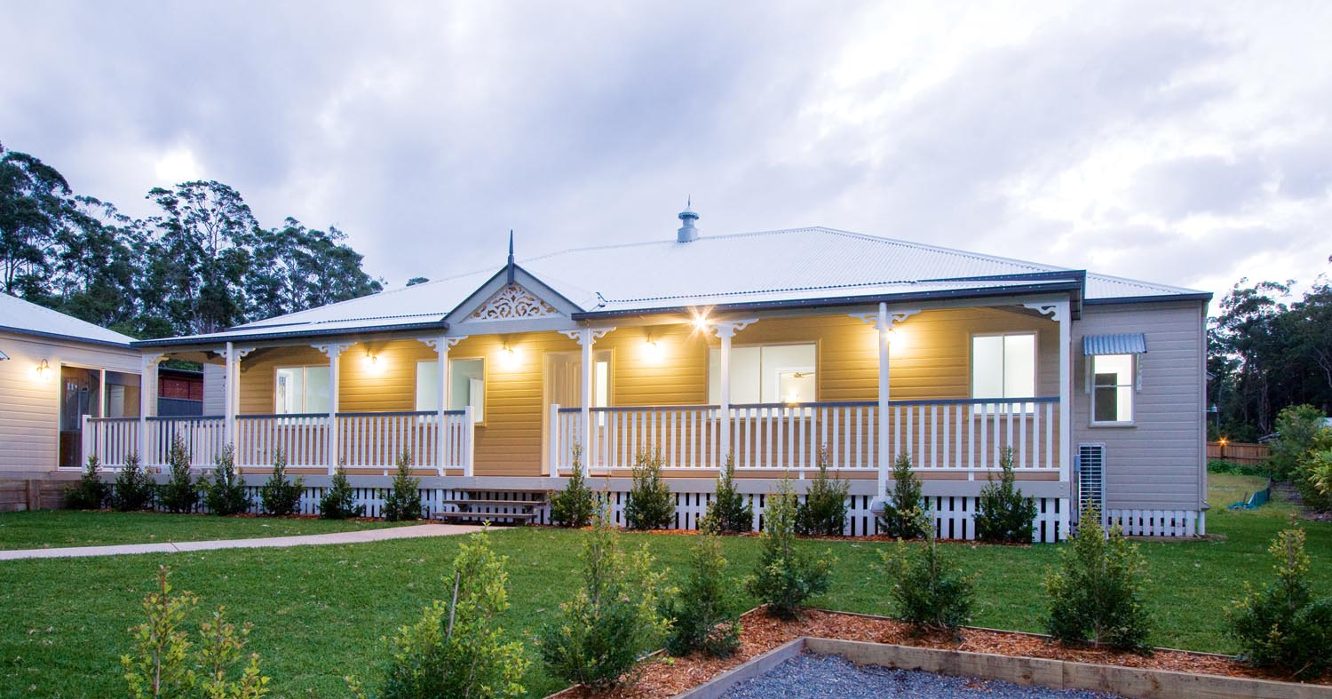 More for less: a classic Queenslander home - exterior 3/4 view at dusk 1