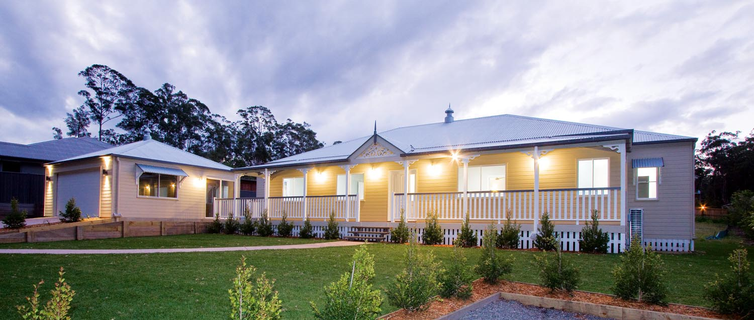 More for less: a classic Queenslander home - exterior 3/4 view at dusk 2