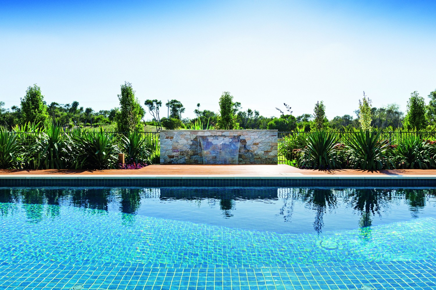 Country pool escape: rural tranquility - panoramic country view with pool in foreground