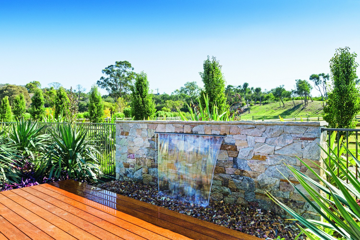 Country pool escape: rural tranquility - water feature adjacent to pool
