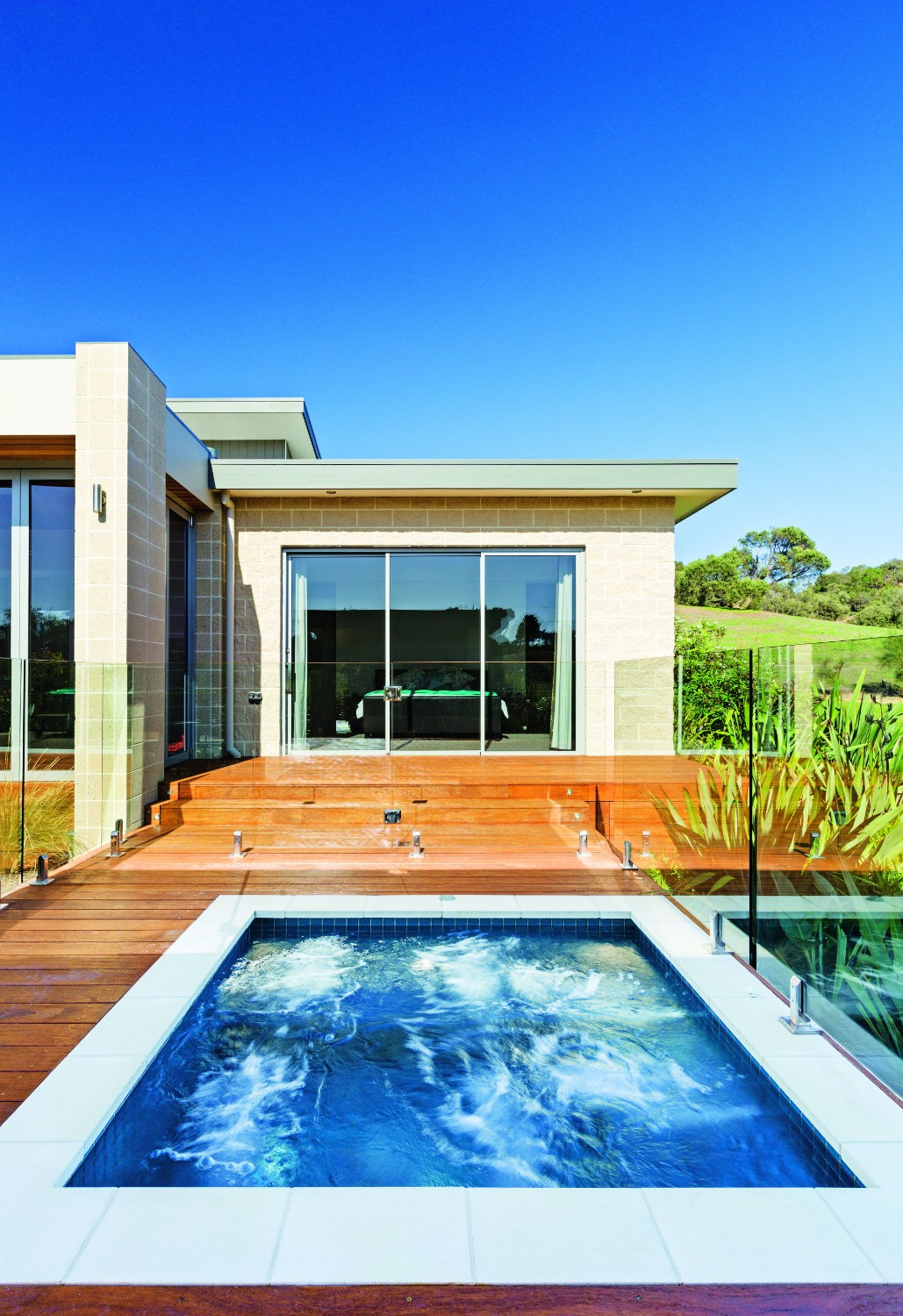 Country pool escape: rural tranquility - the straight-lined pool design complements the architect designed home