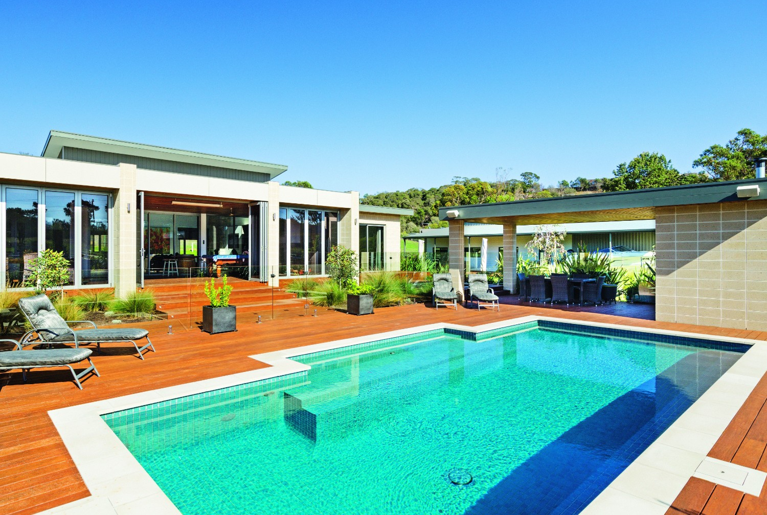 Country pool escape: rural tranquility - side view of pool and house