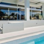 The secret to stunning pool fencing: treated glass