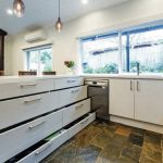 Old charm, new tricks: a kitchen with more comfort, storage & functionality