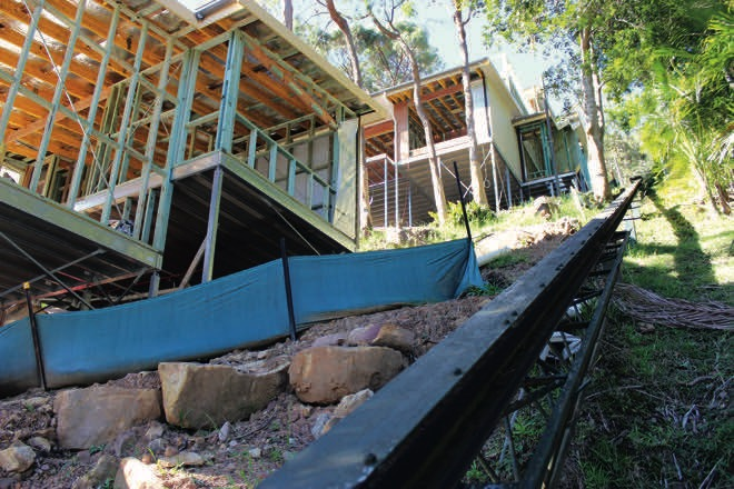 Working smarter: overcoming a steeply sloping site with steel kit flooring