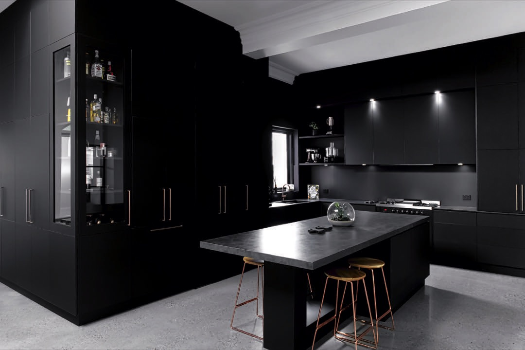 A dark, moody and luxurious kitchen by Alby Turner and Son