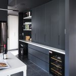 The dazzling darkness of this black and white kitchen