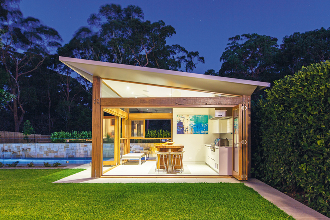 A contemporary cabana ties together this decadent pool and backyard