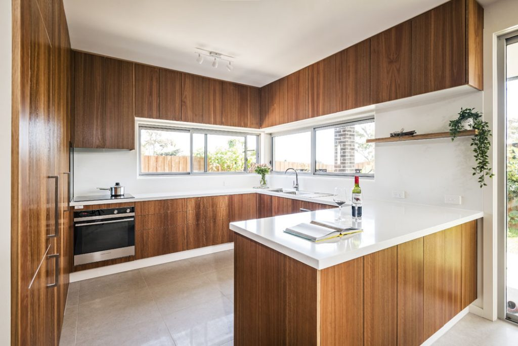 This timber kitchen goes against the grain of typical design