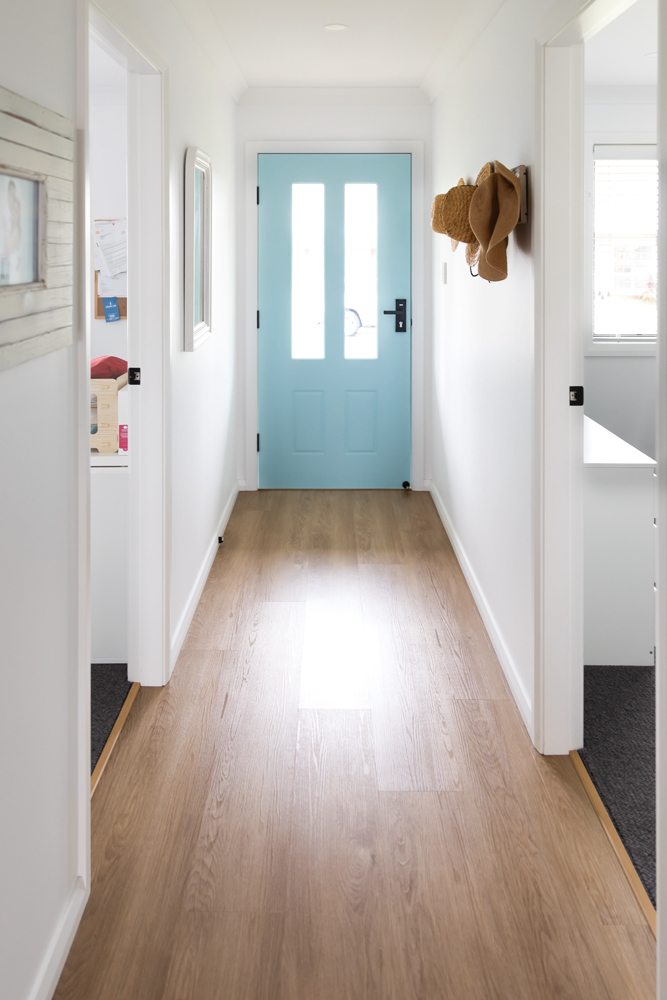This contemporary coastal cottage uses AquaLife flooring