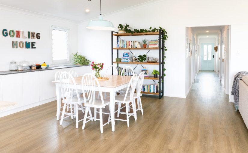 This contemporary coastal cottage uses AquaLife flooring