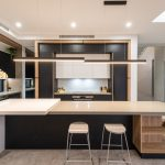 Custom-built bookshelf integrates perfectly in this timber kitchen