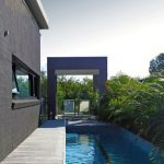 An amazing integrated pool design with shade structure