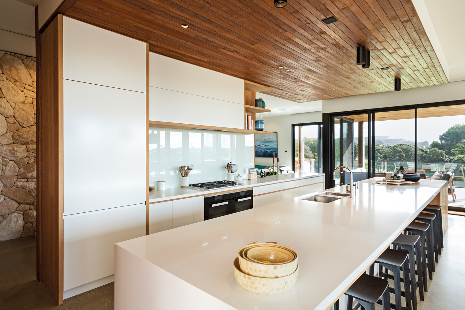This modern minimalist kitchen blends natural light with timber features