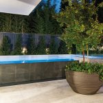 This luxurious Melbourne pool uses large-format grey tiles to make a statement