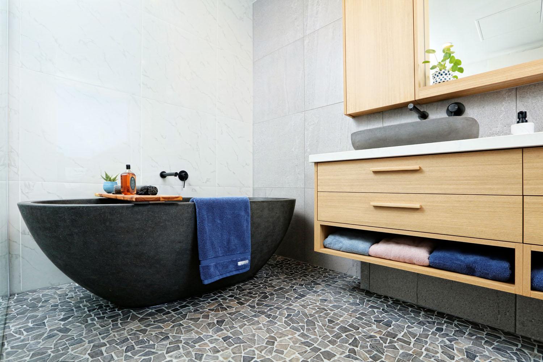 Vanity & Bath With Pebble Floor