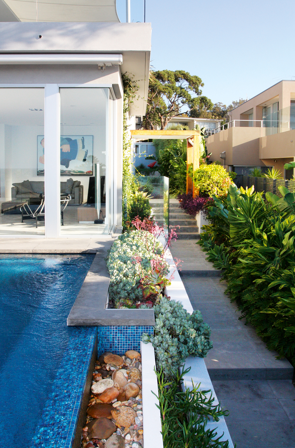 A Northern Beaches garden that blends coastal views with understated design