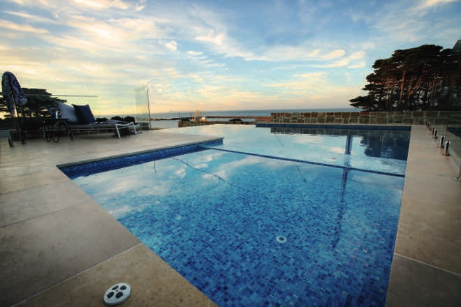 This infinity-edge pool overlooking Port Phillip Bay blends seamlessly with the ocean