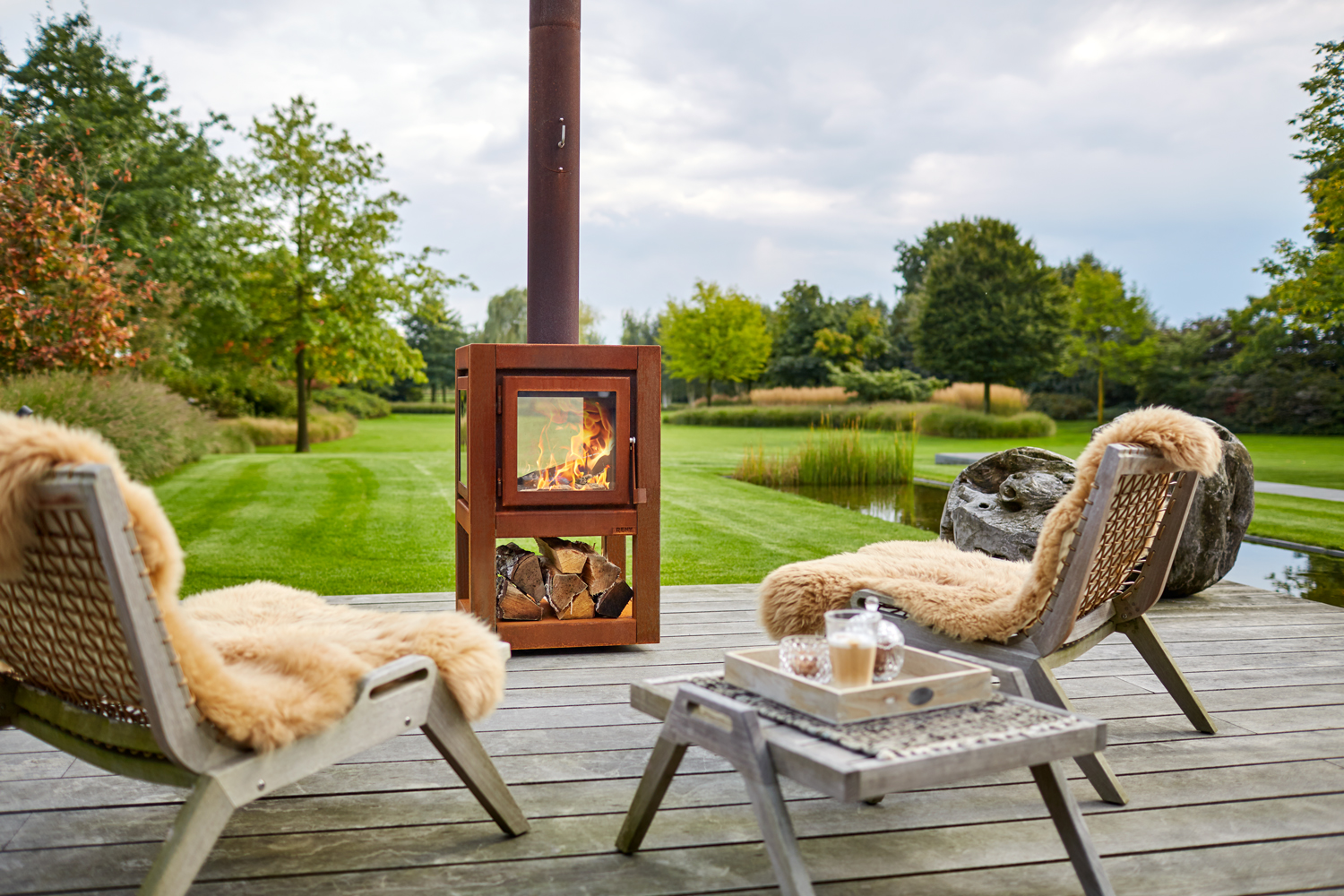 These CorTen steel fireplaces are perfect for year-round entertaining