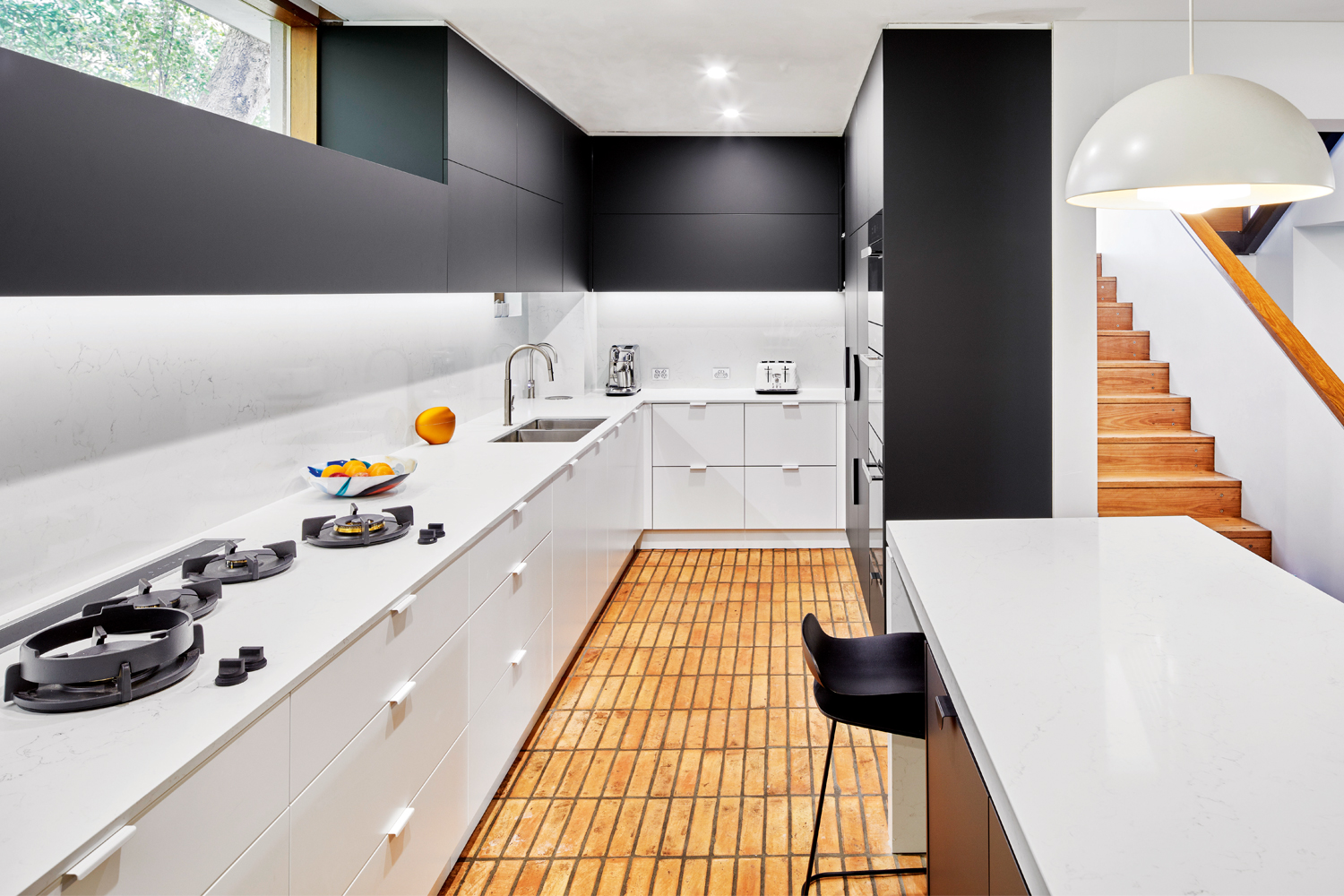 This modern and open kitchen design offers a bold update
