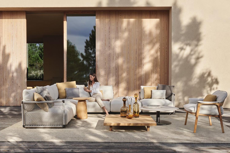 Nodi outdoor sofa, Dunes teak side table, Vis-a-Vis teak coffee table, T Coffee Table, Nomad easy chair and Shindi rug.