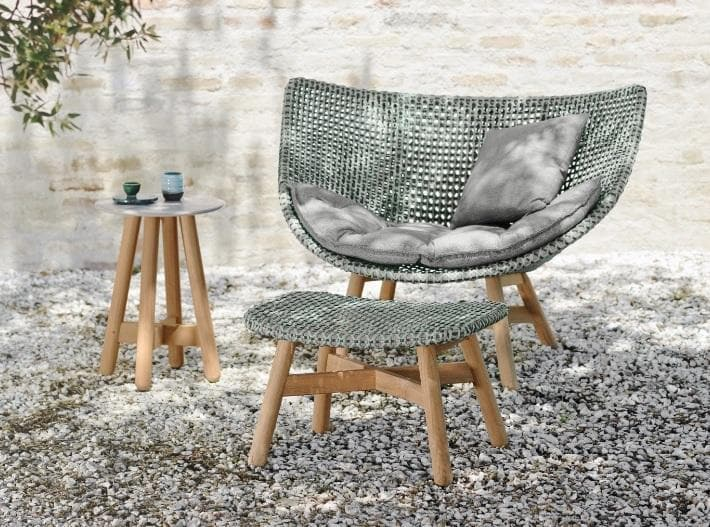 Outdoor living at its finest. Enjoy a quiet moment in the MBRACE lounge chair and footstool, with refreshments on the MBRACE side table.