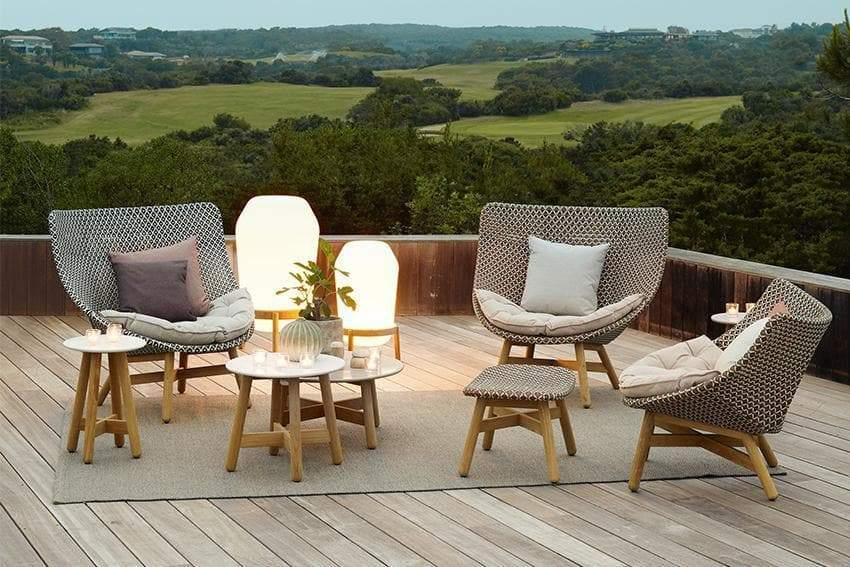 Loon Lanterns in two sizes, sitting with the Mbrace collection. Both collections in the outdoor setting were designed by leading designer Sebastian Herkner.
