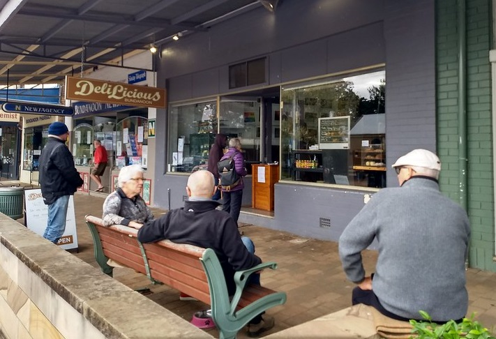 Waiting at arm's length for our pies at Bundanoon. (RE)