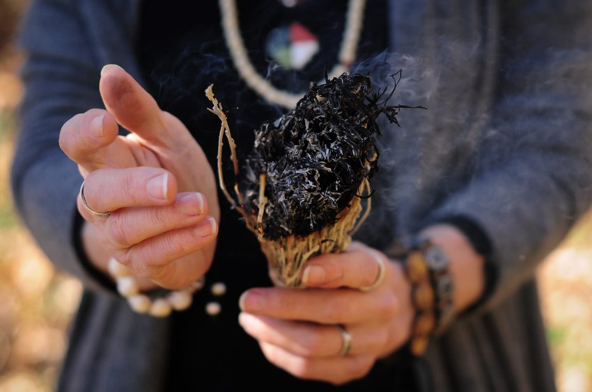 Woman burning sage