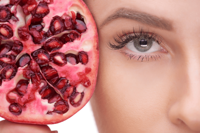 Woman's face and pomegranate