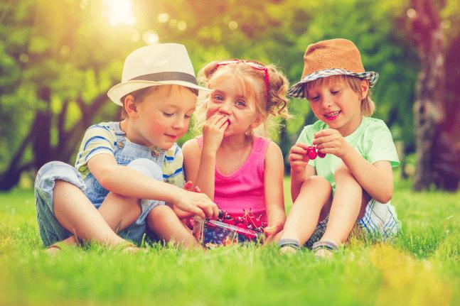 Children with summer berries