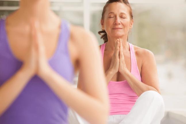 Mature woman in yoga class