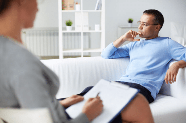 Man in consultation with therapist