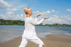 Older woman performing Tai Chi