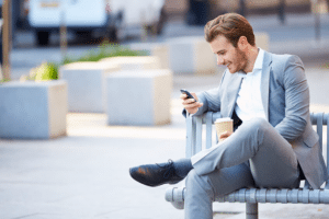 Man sitting using phone