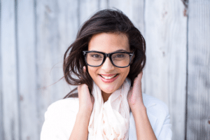 Woman smiling wearing glasses