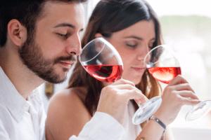 Couple wine tasting red wine
