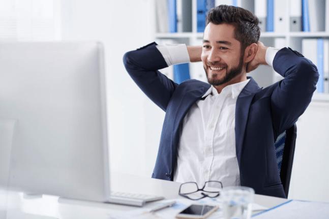 Cheerful businessman at desk
