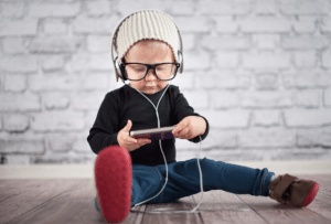 Small child playing with music